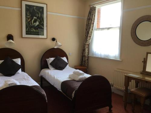 A bed or beds in a room at THE RAILWAY HOTEL