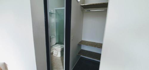 Um banheiro em Hospedaria Cristama