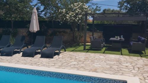 The swimming pool at or near Family villa Oaza in Pula