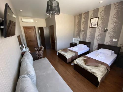 Кровать или кровати в номере Отель Параллель