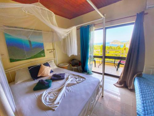 A bed or beds in a room at Avra Sunset Sea View Liapades