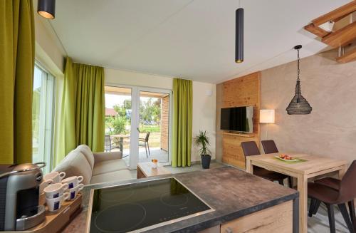 Ein Sitzbereich in der Unterkunft Bachhof Resort Apartments