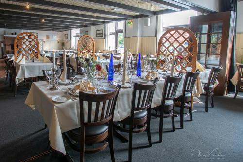 En restaurant eller et andet spisested på Hotel Tannishus