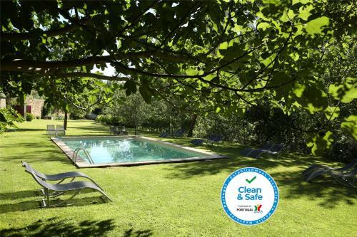 The swimming pool at or near Casa Agricola da Levada Eco Village