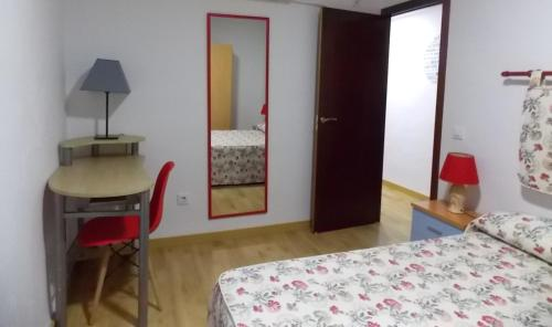 Cama o camas de una habitación en Apartamentos Capuchinas