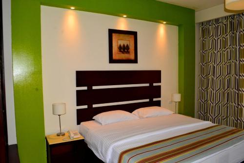 A bed or beds in a room at Nubia Beach Resort & Aqua Park - Hurghada