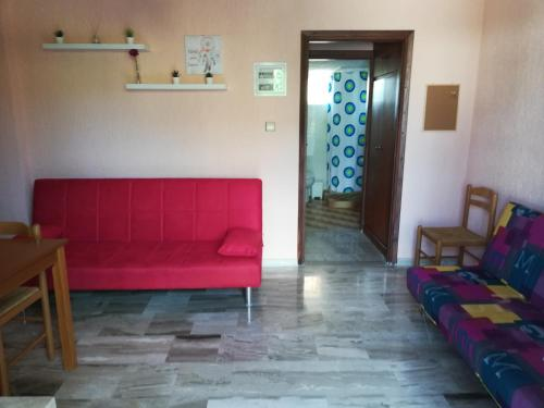 Area soggiorno di Angelos Κandia Apartments