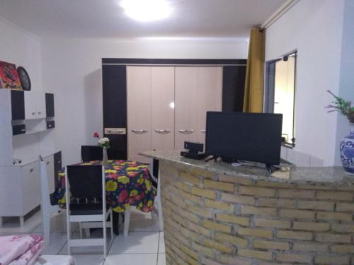 A television and/or entertainment center at Hostel A Cozinha de Cora
