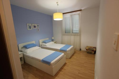 A bed or beds in a room at Apartments Chiara