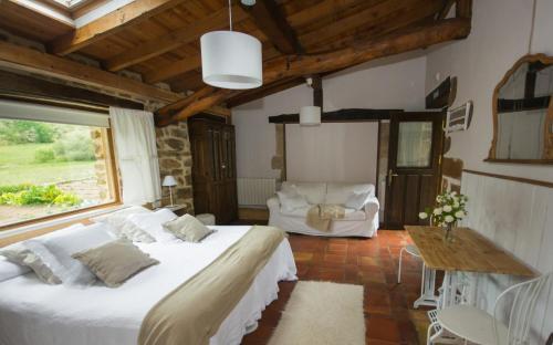 Cama o camas de una habitación en La Gándara