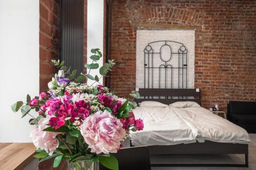 Кровать или кровати в номере Griboedova 29 апартамент отель