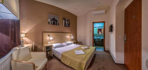 A bed or beds in a room at Budapest City Pension - contactless self check-in