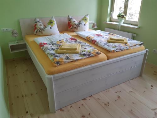 Ein Bett oder Betten in einem Zimmer der Unterkunft Pension am Mönchskirchhof