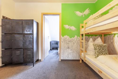 A bunk bed or bunk beds in a room at BrauHotel Bonn