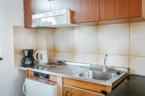Η κουζίνα ή μικρή κουζίνα στο Konaki Apartments