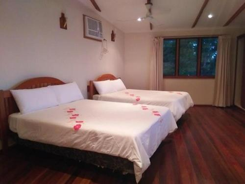 A bed or beds in a room at Tawali Resort