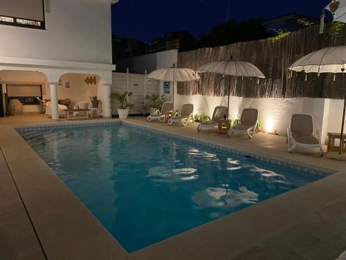 The swimming pool at or near Casa Holandaluzas