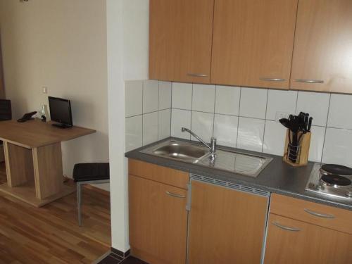Küche/Küchenzeile in der Unterkunft Gästehaus Hubertus Bad Aibling