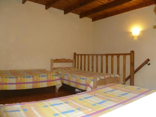 A bed or beds in a room at Departamentos Ailen