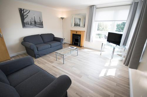 A seating area at Lochend Serviced Apartments