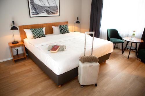 Ein Bett oder Betten in einem Zimmer der Unterkunft Comfort Hotel tom Kyle