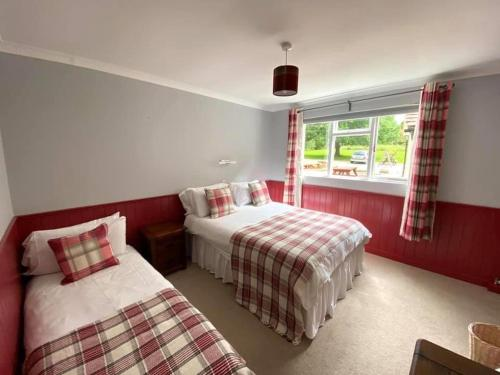 A bed or beds in a room at The Benett Arms