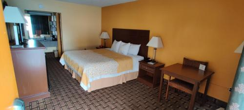 A bed or beds in a room at Days Inn by Wyndham Dickson