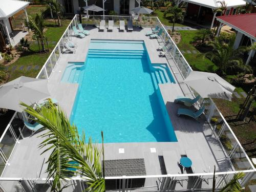 A view of the pool at Hôtel & Villa Le Cocotel or nearby
