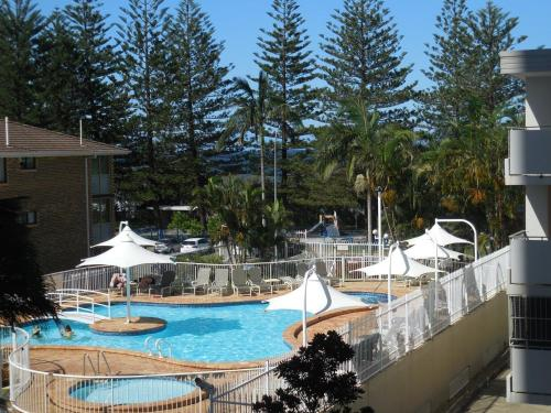 A view of the pool at 2nd Avenue Beachside Apartments or nearby