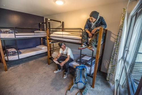 A bunk bed or bunk beds in a room at YHA Queenstown Lakefront