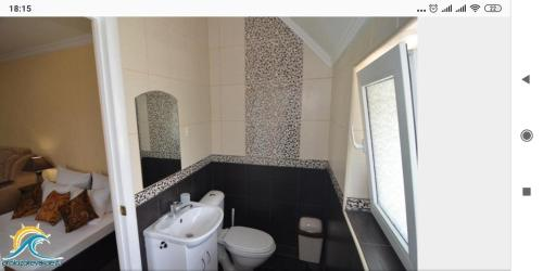 Ванная комната в Гостевой дом Колибри