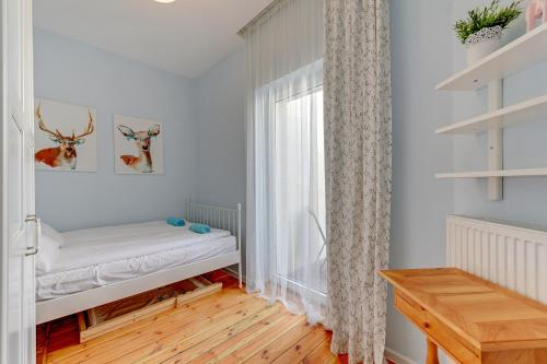 A bed or beds in a room at Dom & House - Apartments Monte Cassino City Center