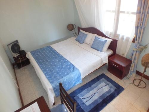 A bed or beds in a room at Family Nest Guesthouse