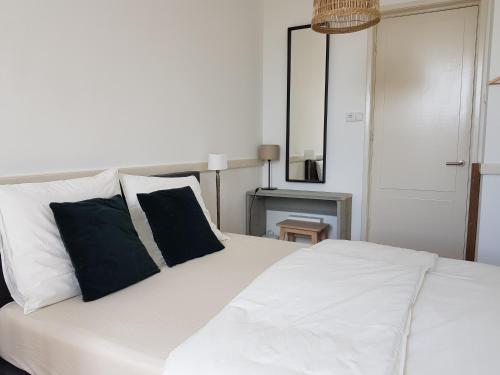 Een bed of bedden in een kamer bij Picco Bello