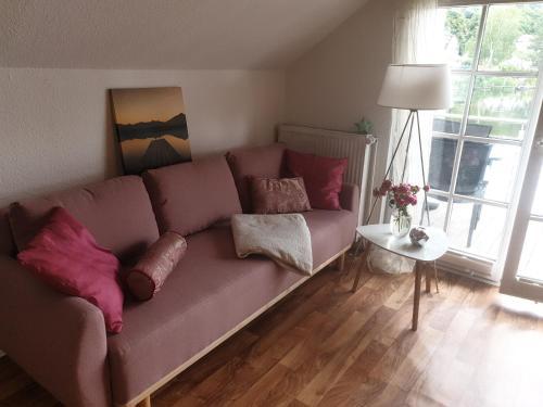 Ein Sitzbereich in der Unterkunft Apartment am Stadtsee