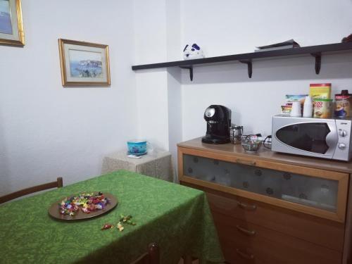Cucina o angolo cottura di B&B Argentiera 12