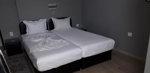 A bed or beds in a room at Guest Rooms Tivona