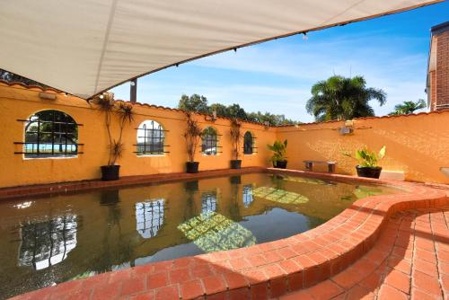 The swimming pool at or near Adobe Motel
