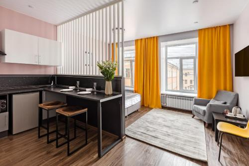 A kitchen or kitchenette at Renome Hotel