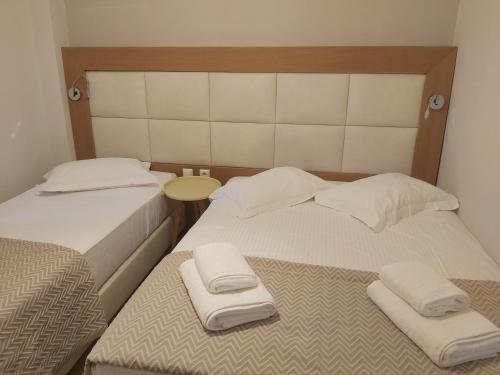 Ein Bett oder Betten in einem Zimmer der Unterkunft Villa Roussa