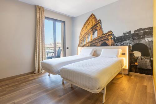 A bed or beds in a room at B&B Hotel Roma Tuscolana San Giovanni