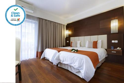 Uma cama ou camas num quarto em Avenida de Fatima