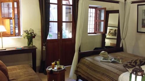 A bed or beds in a room at Riad Al Ksar & Spa