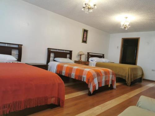 Cama ou camas em um quarto em Hotel Rosim
