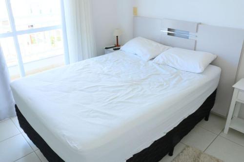 A bed or beds in a room at Lindo apartamento de 3 quartos em Jurerê Florianópolis, ideal para famílias