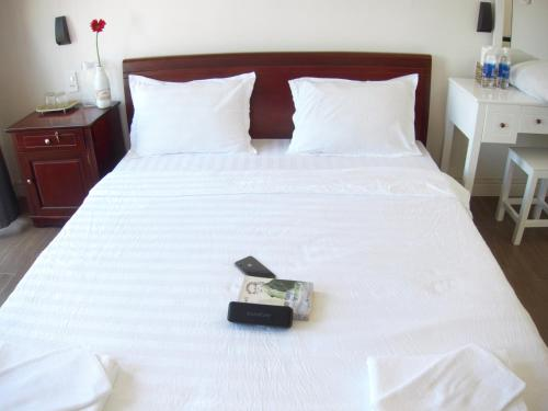 A bed or beds in a room at Lama Homestay