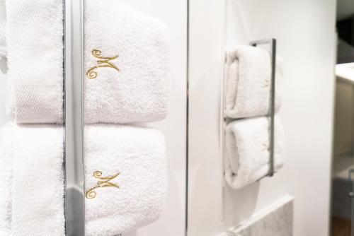 Salle de bains dans l'établissement Hôtel Merveilleux Côté Mer