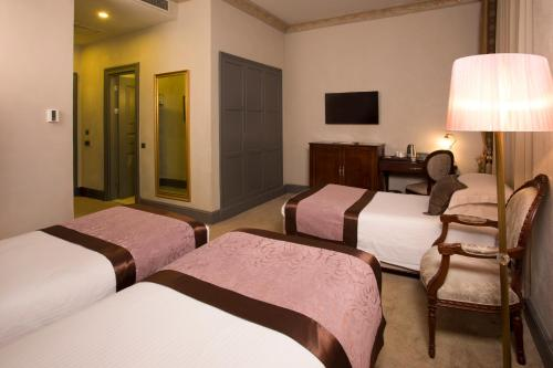 A bed or beds in a room at Palazzo Donizetti Hotel - Special Class