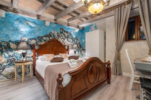 Ein Bett oder Betten in einem Zimmer der Unterkunft Heritage Palace Varoš