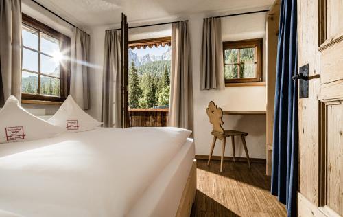 Ein Bett oder Betten in einem Zimmer der Unterkunft Mountain Resort Patzenfeld